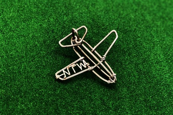 3D plane charm with initial. In silver.